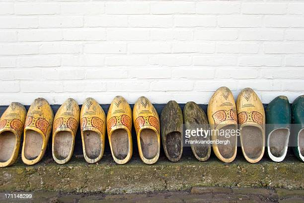 wooden shoes in a row - clogs stock pictures, royalty-free photos & images