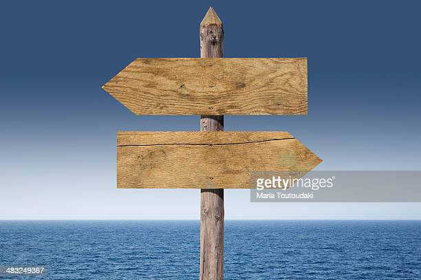 Wooden sign close to the sea