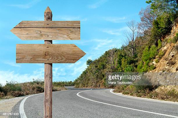 Wooden sign in a country road