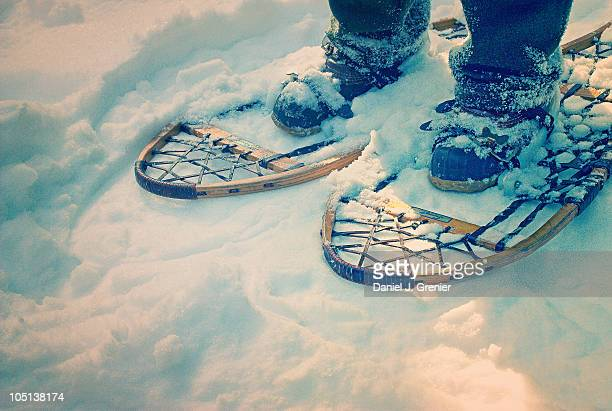 Wooden Snowshoes in Snow