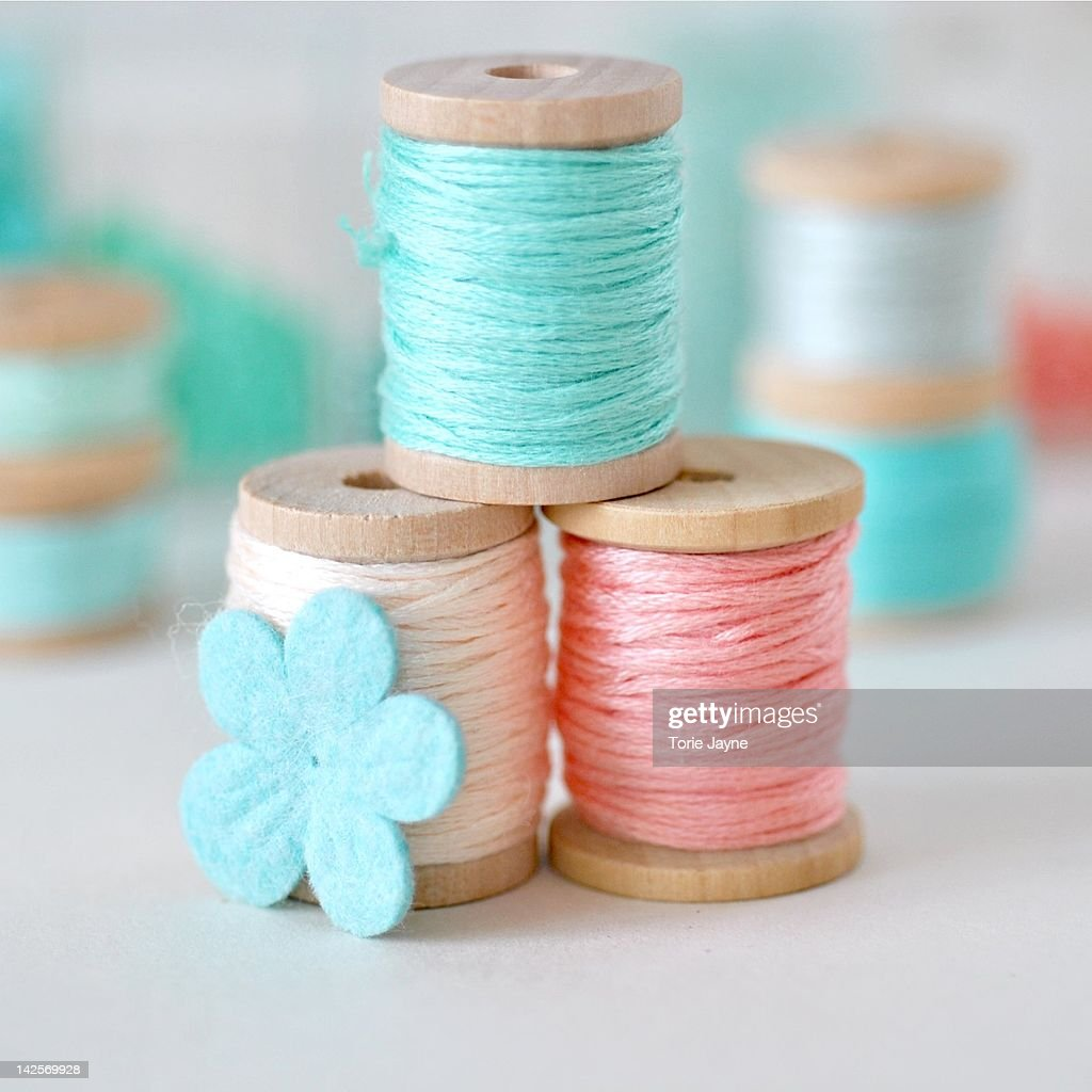 Wooden spools wrapped with embroidery thread : Stock Photo