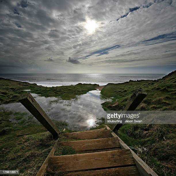 wooden stairs at sea - s0ulsurfing stock pictures, royalty-free photos & images