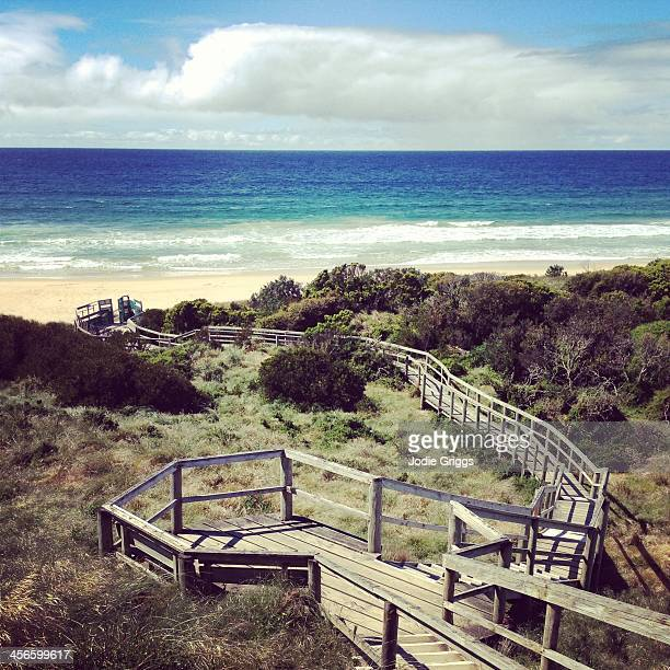Wooden stairs leading down through dunes to beach