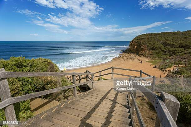 Wooden stairs leading down to a beach