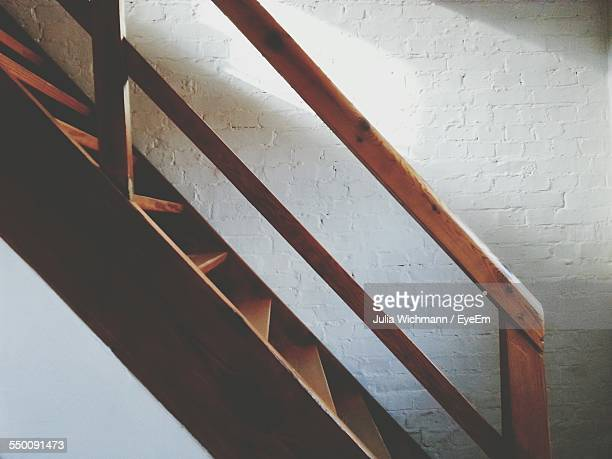 Wooden Stairway Against Wall