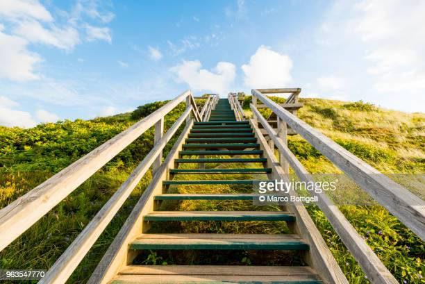 wooden stairway uphill, sylt island. - uphill stock pictures, royalty-free photos & images