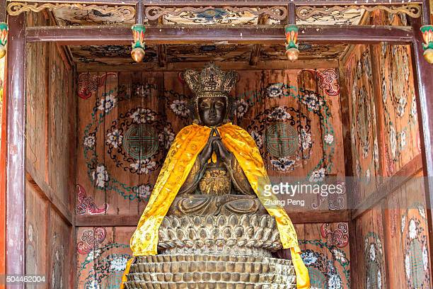 A wooden statue of Pilu Buddha from Ming Dynasty in the 1000 Buddha Palace Hall The Shaolin Monastery or Shaolin Temple is a Chan Buddhist temple and...