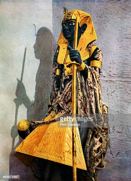 Wooden statue of Tutankhamun Egypt 19331934 Statue of Tutankhamun one of two that stood outside the sealed up entrance to his sepulchral chamber The...