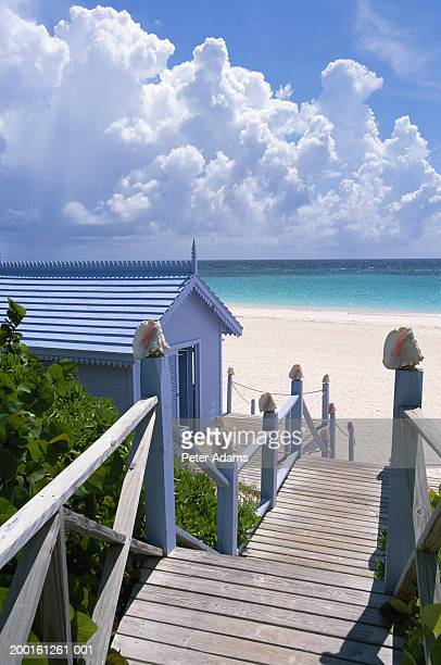 wooden steps leading down to beach - harbor island bahamas stock photos and pictures