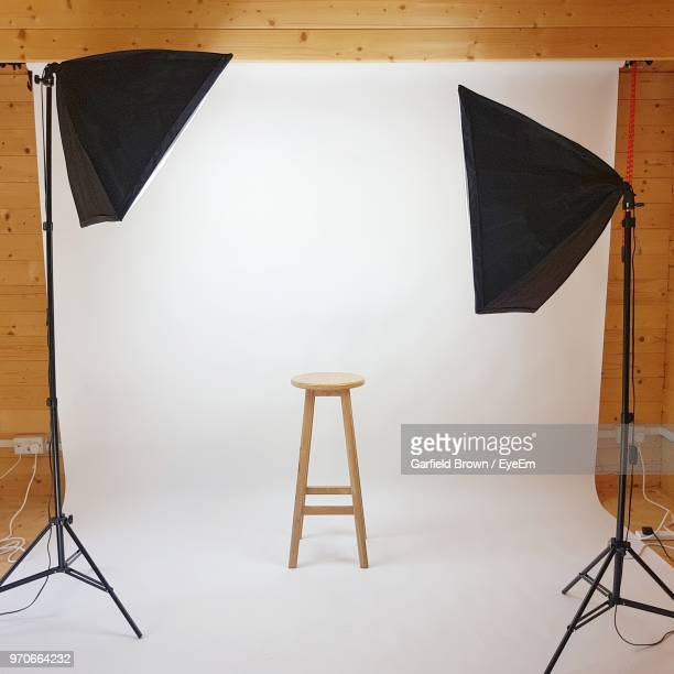 Wooden Stool Against White Backdrop At Studio