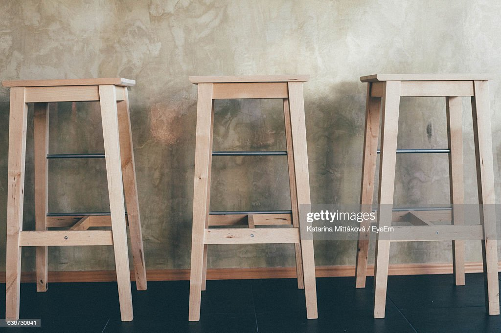 Wooden Stools Against Counter At Bar : ストックフォト