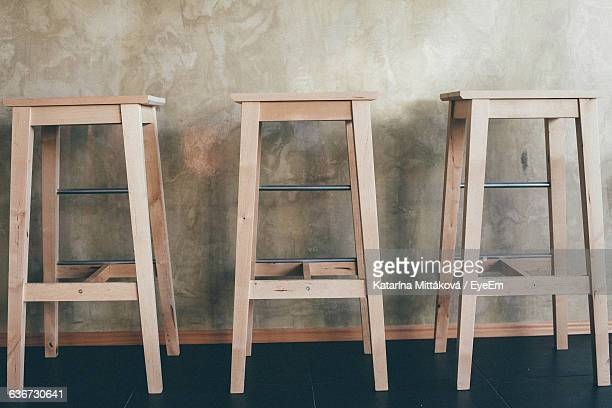 Wooden Stools Against Counter At Bar