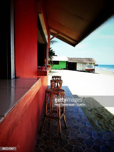Wooden Stools By Counter On Beach Restaurant
