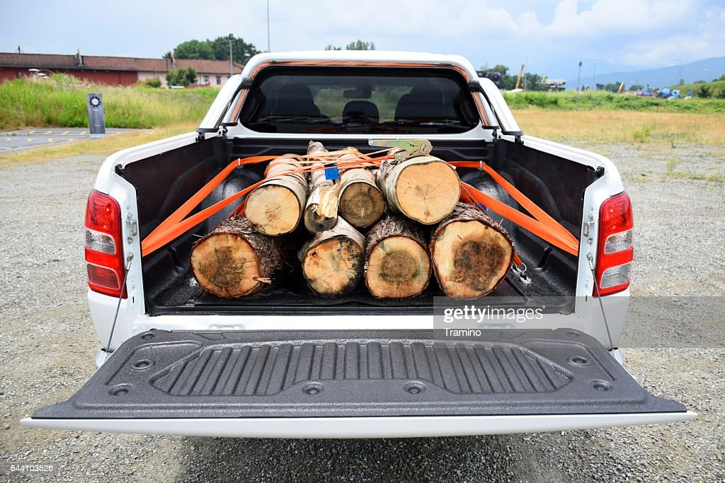 Wooden stumps on the pick-up truck : Stock Photo