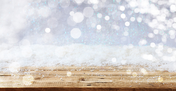 Wooden surface Christmas snowy background 1008906482