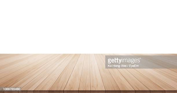 wooden table against white background - plank timber stock photos and pictures