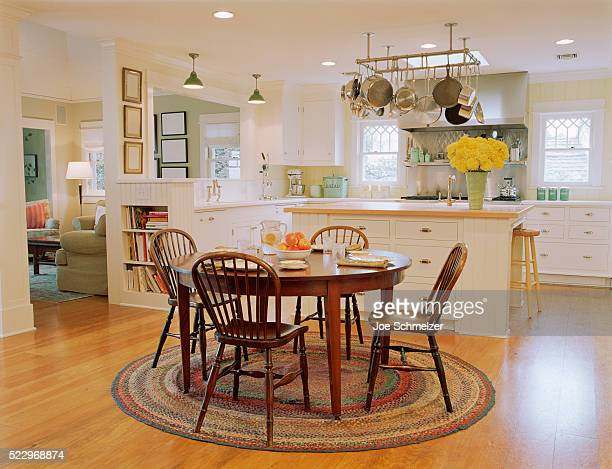 wooden table and chairs in traditional kitchen - archival - fotografias e filmes do acervo