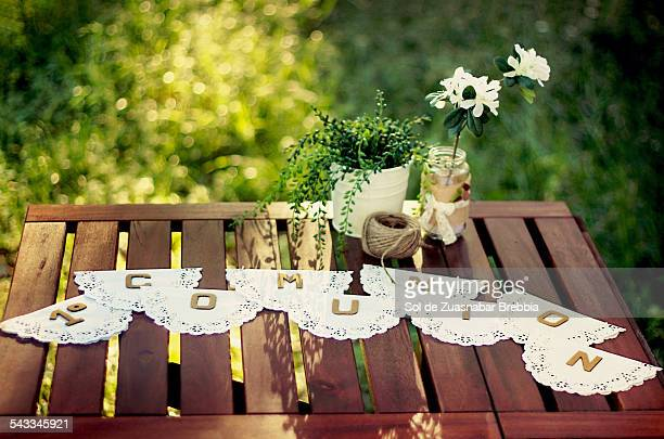 Wooden table holding details for first communion