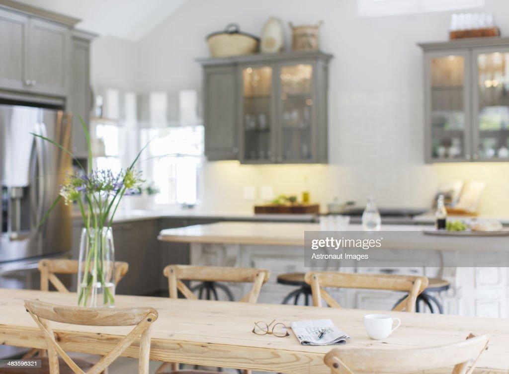 Wooden table in luxury kitchen : Stock Photo