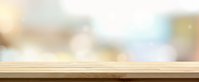 Wooden table top against cafe background 955864930