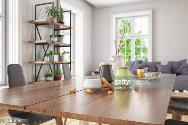 wooden table top with blur of modern living room interior - dinner table stock pictures, royalty-free photos & images