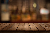 http://www.istockphoto.com/photo/wooden-table-with-a-view-of-blurred-beverages-bar-backdrop-gm517015238-89280601