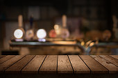 http://www.istockphoto.com/photo/wooden-table-with-a-view-of-blurred-beverages-bar-backdrop-gm578088720-99347469