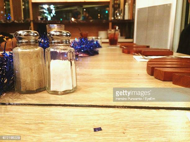 Wooden Table With Salt And Pepper Shaker