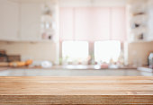 Wooden tabletop over defocused kitchen background