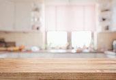 Wooden tabletop over defocused kitchen background