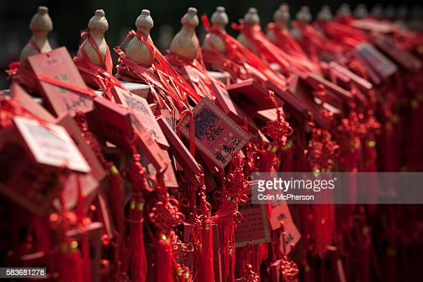 Wooden tablets left by visitors and disciples hanging from railings at the Confucius Temple and Guozijian in Beijing China The complex was first...