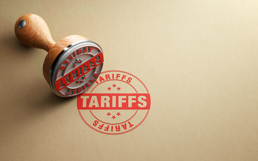 Wooden Tariffs Stamp Is Sitting On Recycled Paper Background 1059636540
