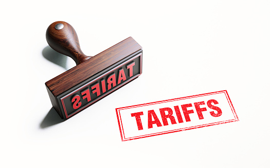 Wooden Tariffs Stamp On White Background 1054696188