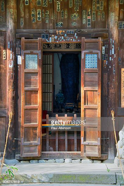CONTENT] A wooden temple door in Kamakura Japan