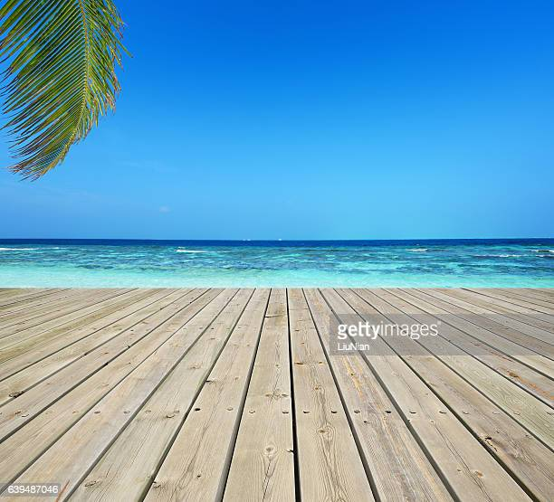 wooden terrace and tropical seascape - boardwalk stock pictures, royalty-free photos & images