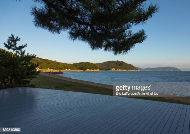 Wooden terrace beside tropical sea in Benesse house hotel Seto Inland Sea Naoshima Japan on August 24 2017 in Naoshima Japan