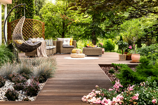 Wooden terrace surrounded by greenery 957245348