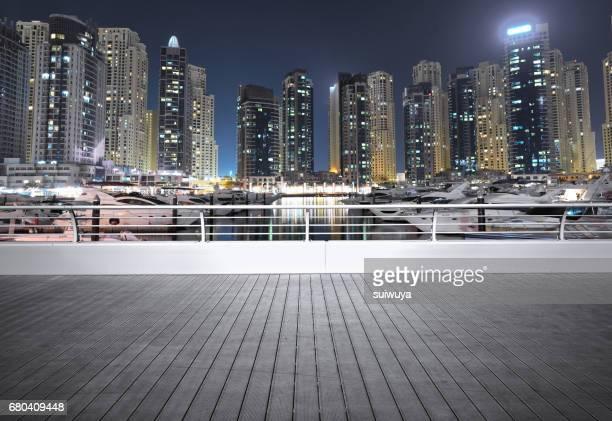 Wooden terrace with Dubai Marina background