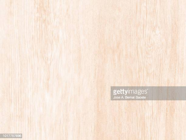 wooden texture detail ancient outdoors with beige painting, full frame. - hout stockfoto's en -beelden