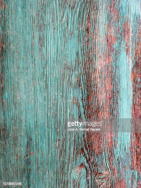 Wooden texture detail ancient outdoors with green painting, full frame.