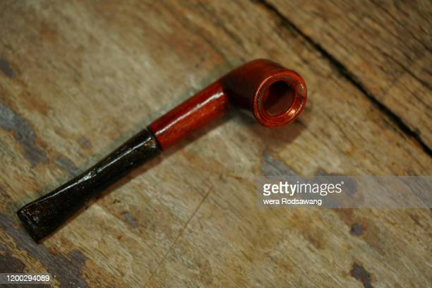 wooden tobacco smoking pipe - pipe stock pictures, royalty-free photos & images