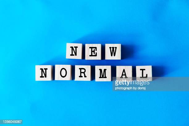 wooden toy block, words - new normal - new normal concept stock pictures, royalty-free photos & images