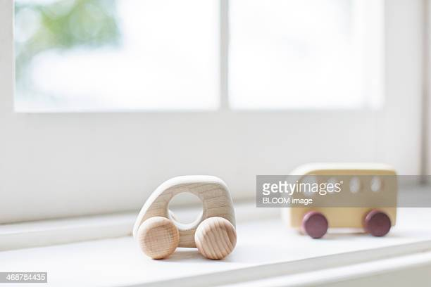 Wooden toy cars on window sill