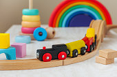 Wooden toy railway and pyramid in the children room
