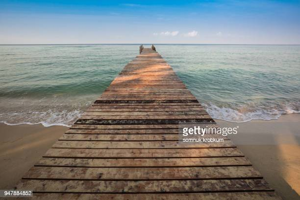 wooden walk path and sea in summer - pedestrian walkway stock pictures, royalty-free photos & images