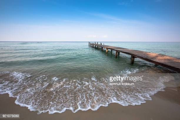 Wooden walk path with blue sea in summer