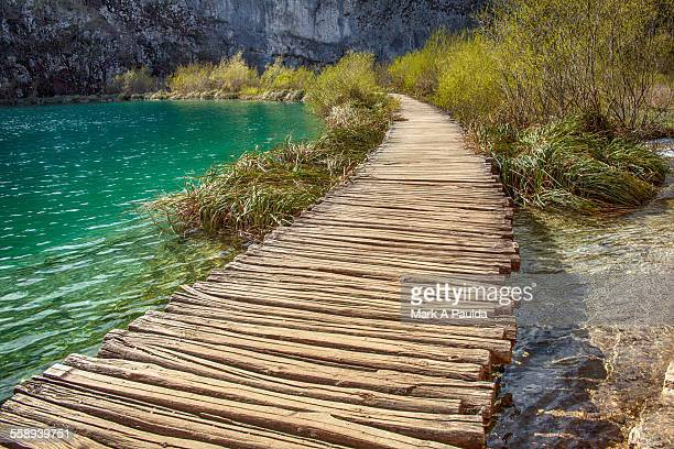 Wooden walking path by river