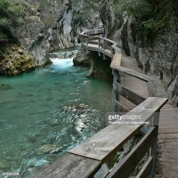 Wooden walkway inside the ravine along alongside the river Borosa in the Cazorla Mountain Range in Jaen, Andalusia, Spain