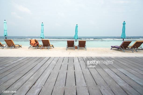 wooden walkway on the sand beach - liu he stock pictures, royalty-free photos & images