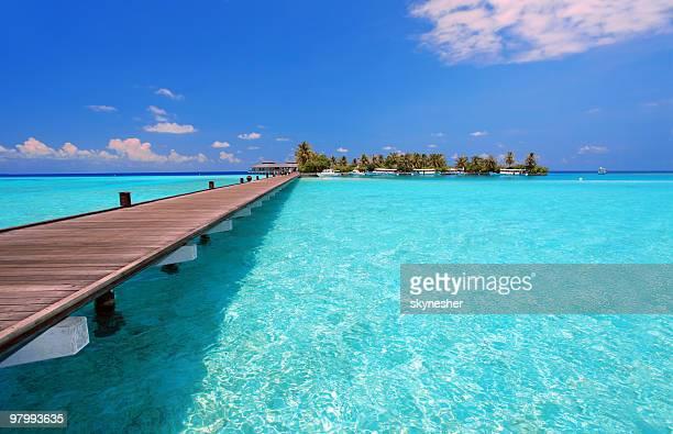 Wooden walkway on tropical Maldivian resort.
